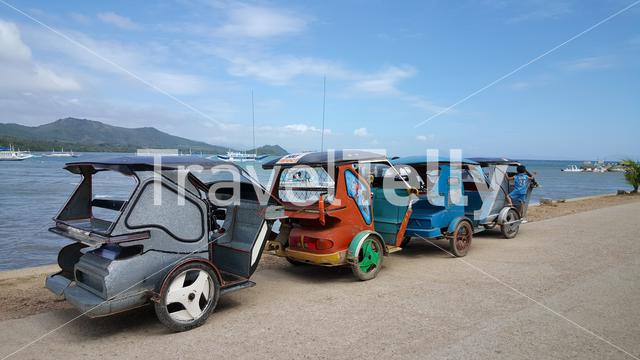 Tricycles in a row at waterfront TayTay, Palawan, Philippines