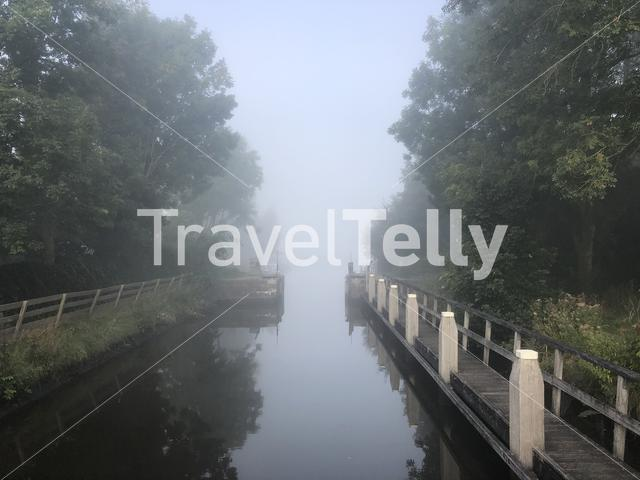 Canal lock on a misty morning around tersoal in Friesland The Netherlands