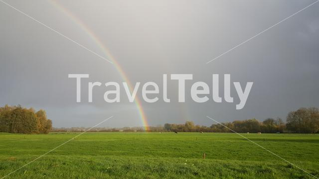 Double rainbow above Dutch landscape