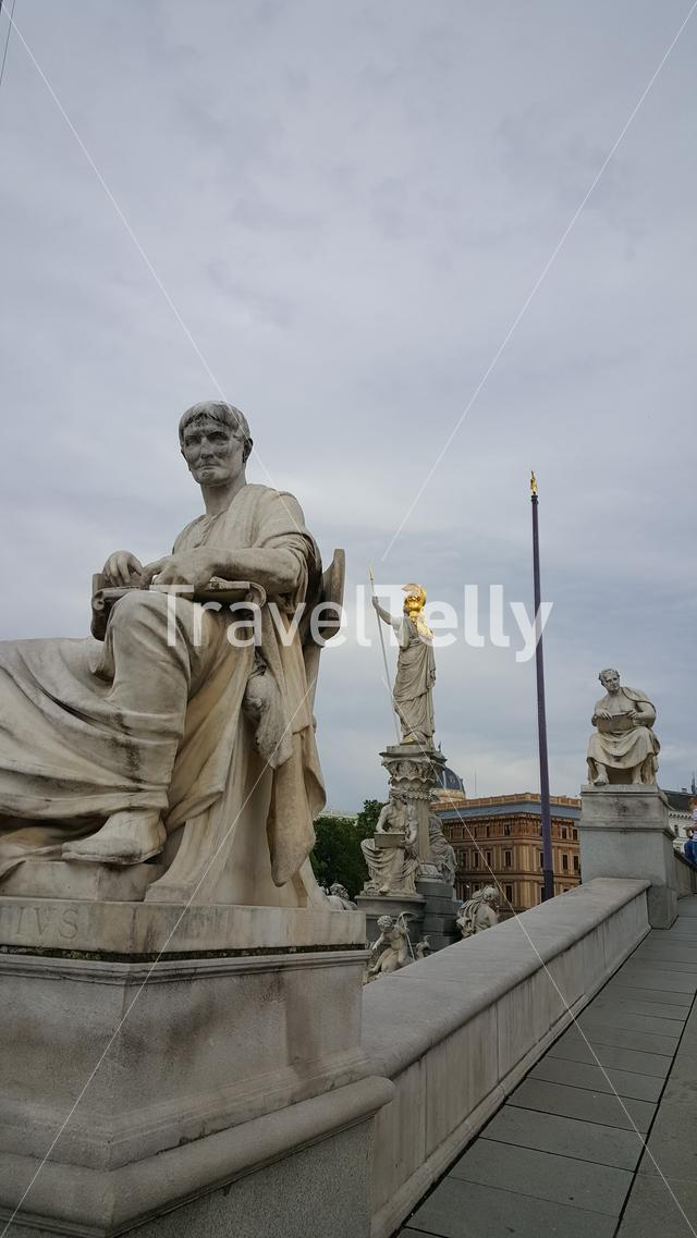 Statue in front of Parlament building Vienna