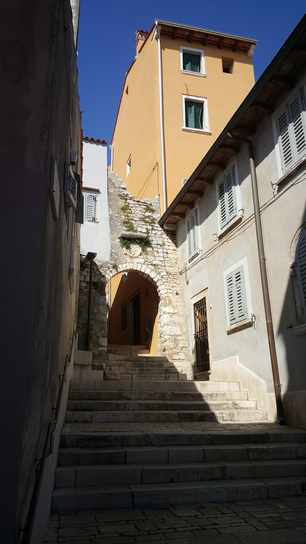 Narrow street with stairs in Rovinj old town, Croatia