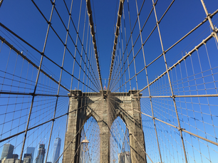 Brooklyn Bridge with the Freedom tower and Manhattan at the background in New York City