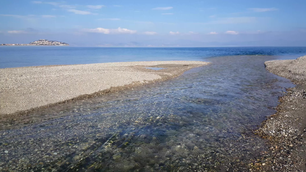Stream going in to the sea from the Igroviotopos Moustou park in Greece