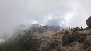 Clouds moving over the Roque Nublo a volcanic rock on the island of Gran Canaria