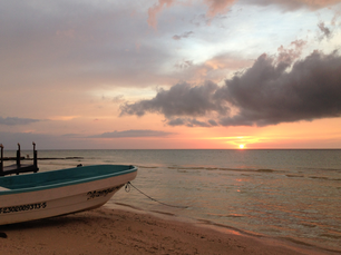 Boat at the beach during sunset at Holbox Quintana Roo Mexico