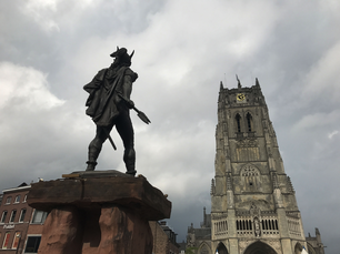 The statue of Ambiorix at the Tongeren Great Market and the Old Cathedral of Tongeren in Belgium
