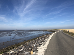 Dyke around the harbor of Ameland island during low tide in Friesland The Netherlands