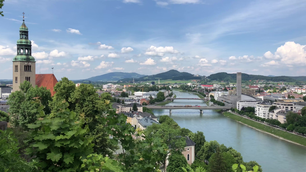 Train passing by over the Salzach river in Salzburg, Austria