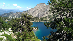 Going down to Josep Maria Blanc mountain shelter, views from  the Estany negre lake, in Aigüestortes national park, Catalonia, Spain.
