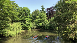 Canoeing through the park in Braunschweig Germany