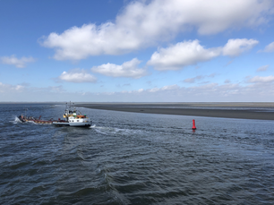 Cargo ship at the wadden sea in The Netherlands