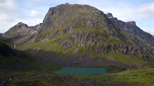 Pan from a mountain landscape with a small lake in Moysalen National Park Norway