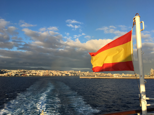 Spanish flag on a ferry who leaves the harbour of Las Palmas Gran Canaria