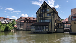 Timber frame houses and the regnitz river in the old town of Bamberg Germany
