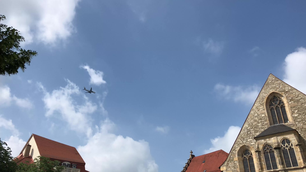 Airplane flying over the old town of Erfurt in Germany