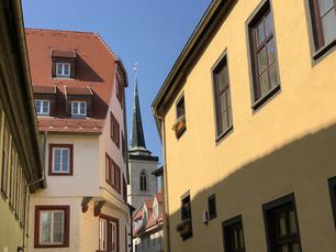 The tower of All Saints Church in the streets of Erfurt Germany