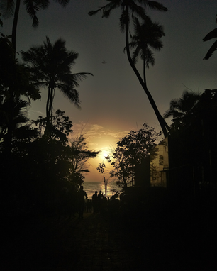 This is famous place in India known as Juhu beach.Go and play some music and just chill with friends