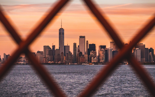 Photo taken from the Staten Island Ferry. Through the fence of the ferry towards Manhatten