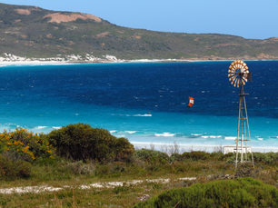 Old windmill and a kite surfer at Lucky Bay beach at Cape Le Grand National Park Australia