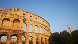 Roman Amphitheatre by sunset in Pula, Croatia