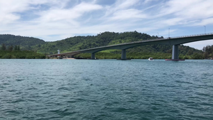 Sailing towards the Siri Lanta Bridge in Koh Lanta, Thailand