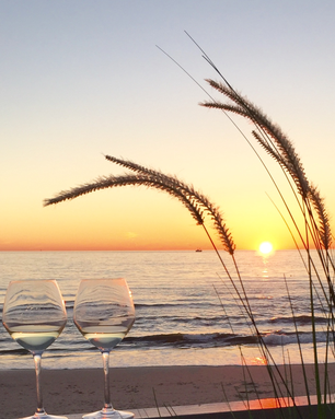 Wine glasses during sunset in Callantsoog in The Netherlands