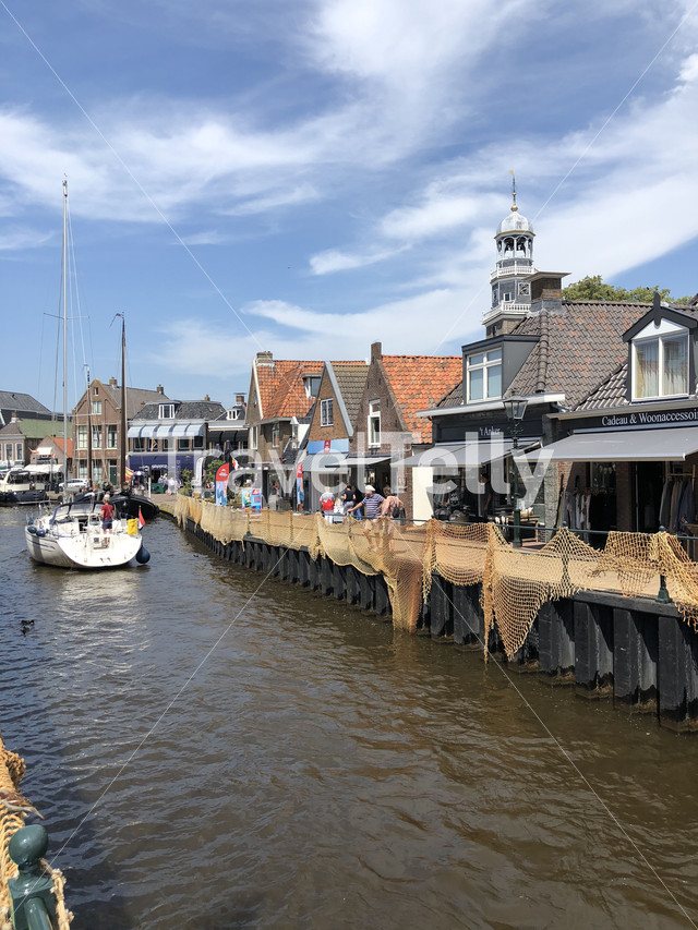 Sailboat in the canal of Lemmer, Friesland The Netherlands