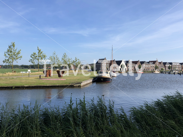 Houses next to a canal in balk, Friesland The Netherlands